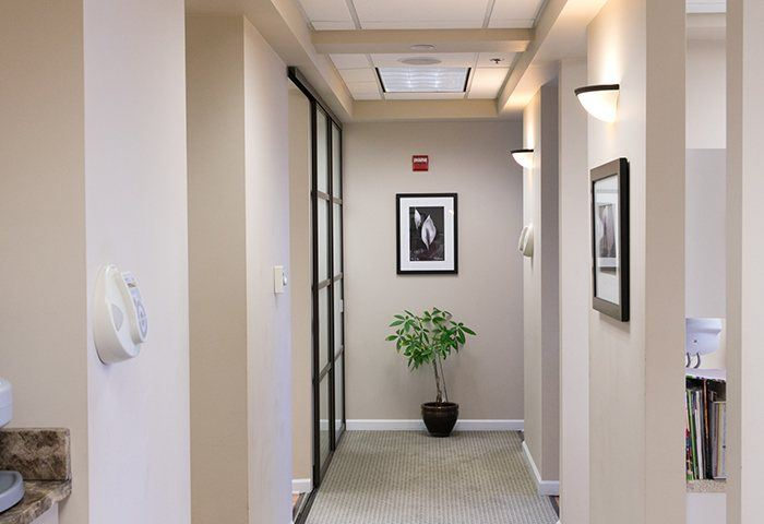 Hallway furnished with pictures and accent plants