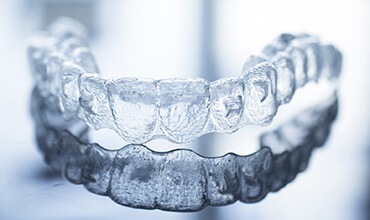Invisalign tray resting on tabletop