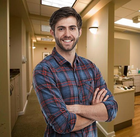 Young man with attractive smile in dental office